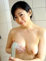 Emiko Koike showers in front of cam